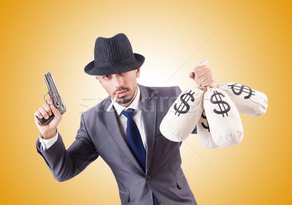 Stockfoto: Zakenman · crimineel · geld · man · achtergrond · zwarte