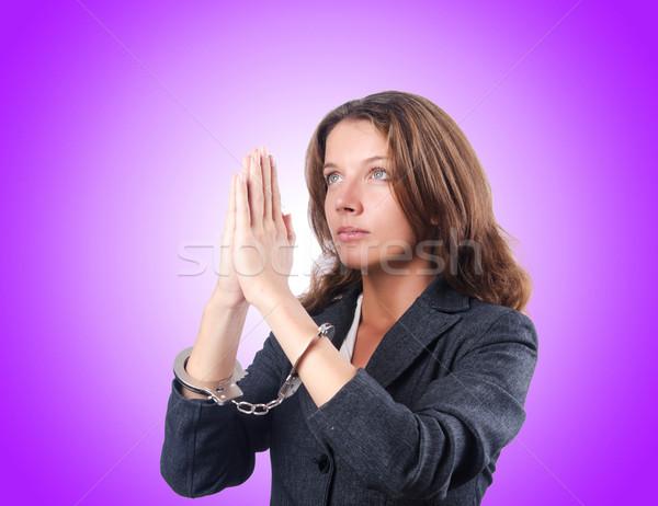 Female businesswoman with handcuffs against gradient  Stock photo © Elnur