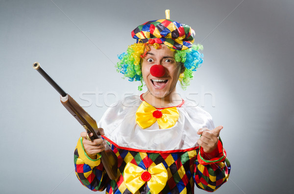 Clown with rifle isolated on white Stock photo © Elnur