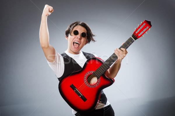 Grappig gitarist musical muziek man gitaar Stockfoto © Elnur