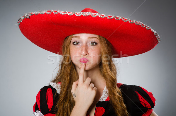 Mexican woman wearing sombrero hat Stock photo © Elnur