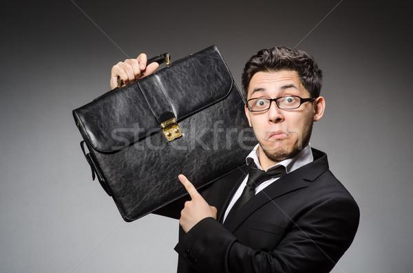 Businessman with handbag against gray Stock photo © Elnur