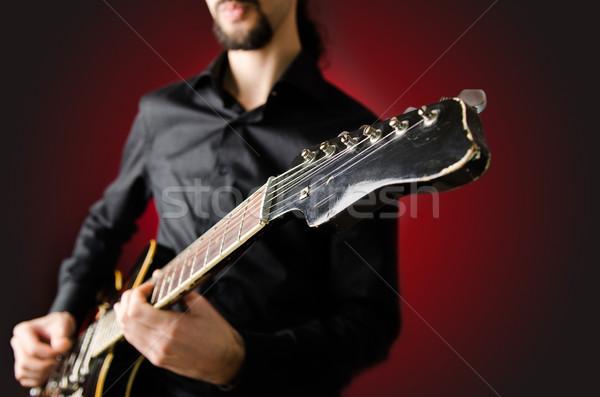 Stockfoto: Man · gitaar · concert · muziek · partij · achtergrond