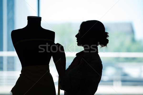 Stock photo: Woman tailor working on new clothing