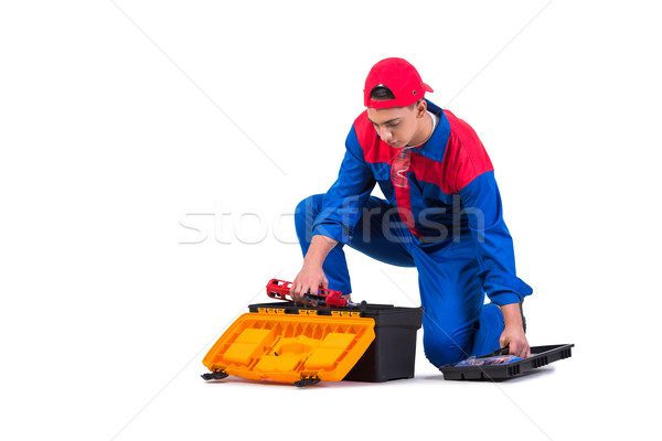Young repairman with silicone gun isolated on white Stock photo © Elnur