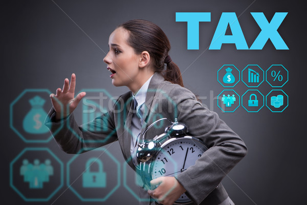 The businessman in late taxes payment concept Stock photo © Elnur