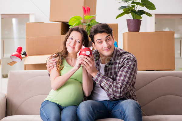 Young couple saving money for baby to be born Stock photo © Elnur