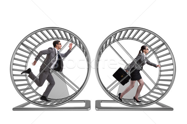 Business concept with pair running on hamster wheel Stock photo © Elnur