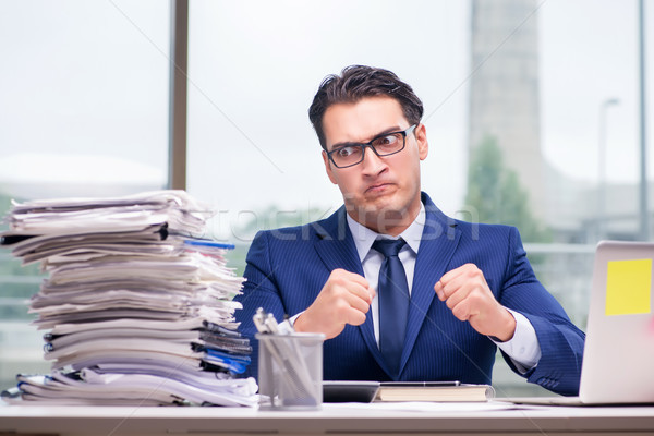 Workaholic businessman overworked with too much work in office Stock photo © Elnur