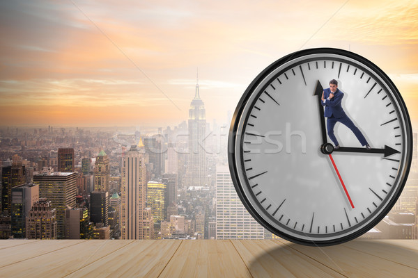 Businessman in time management concept Stock photo © Elnur
