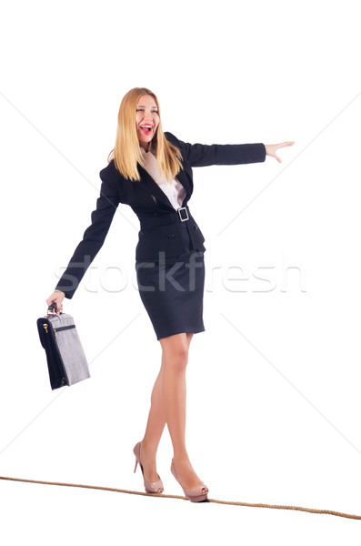 Stock photo: Businesswoman walking on tight rope isolated