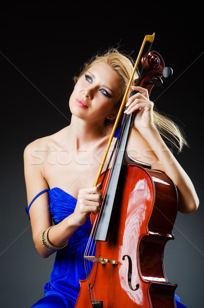Attractive woman with cello in studio Stock photo © Elnur