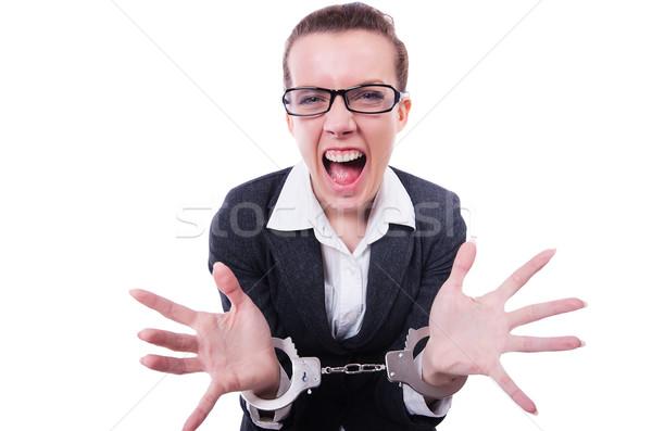 Female businesswoman with handcuffs on white Stock photo © Elnur