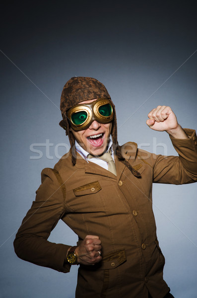 Stock photo: Funny pilot with goggles and helmet