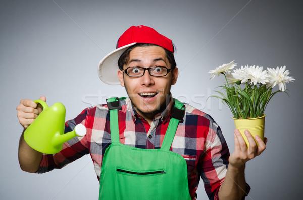 Engraçado homem regador flores sorrir grama Foto stock © Elnur