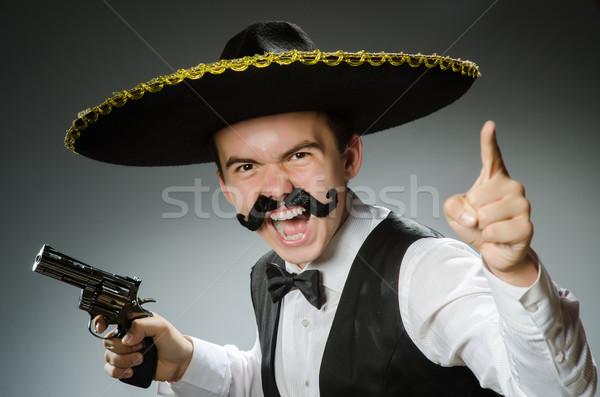 Sorridente mexicano sombrero isolado branco mão Foto stock © Elnur