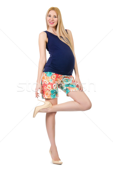 Young pregnant woman in colorful clothing isolated on white Stock photo © Elnur