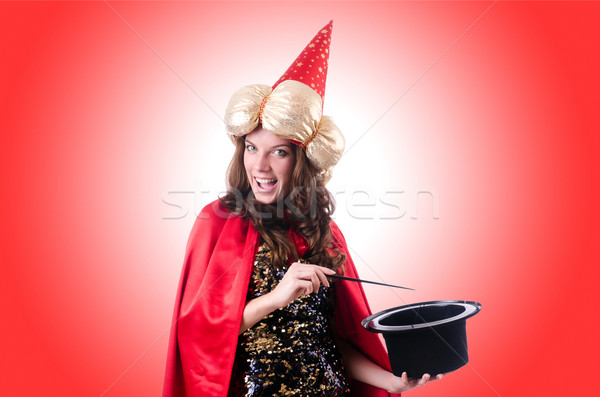 Kobiet magik odizolowany biały kobieta strony Zdjęcia stock © Elnur