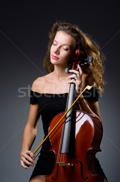 Female musical player against dark background Stock photo © Elnur