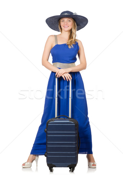 Young woman in blue dress and suitcase isolated on white Stock photo © Elnur