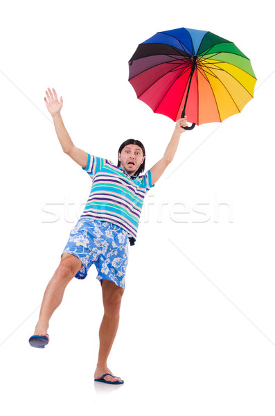 Positive man with colorful umbrella isolated on white Stock photo © Elnur
