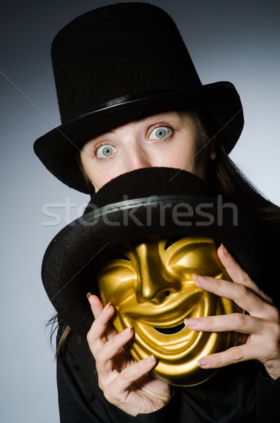 Woman with mask in funny concept Stock photo © Elnur