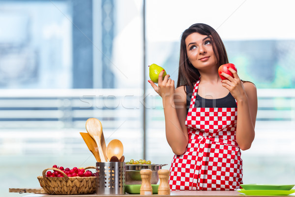 The young cook with fruits in the kitchen Stock photo © Elnur