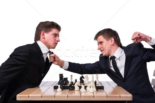 Gêmeo irmãos jogar xadrez isolado branco Foto stock © Elnur