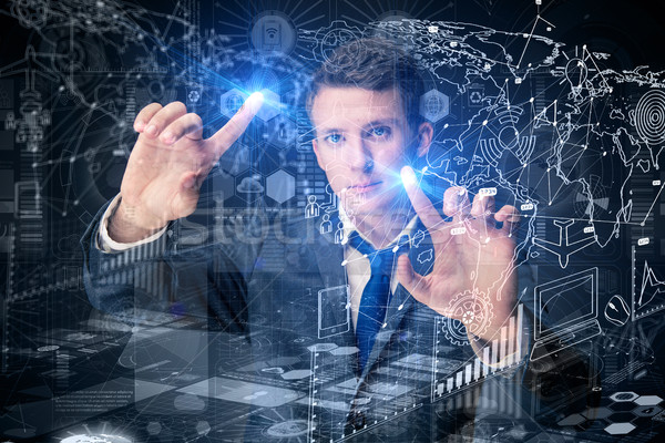 The young man in data management concept Stock photo © Elnur