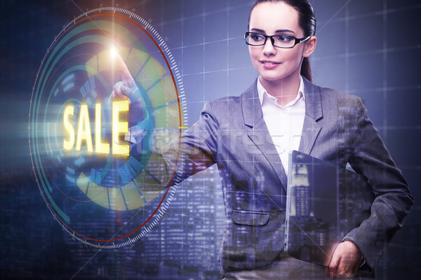 Businesswoman pressing buttons in sale concept Stock photo © Elnur