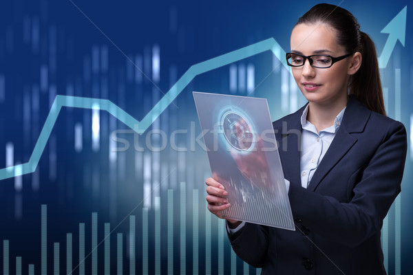 Businesswoman in stock exchange trading concept Stock photo © Elnur
