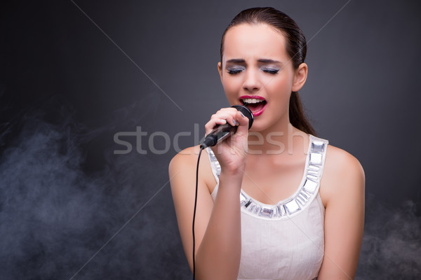 The young girl singing in karaoke club Stock photo © Elnur