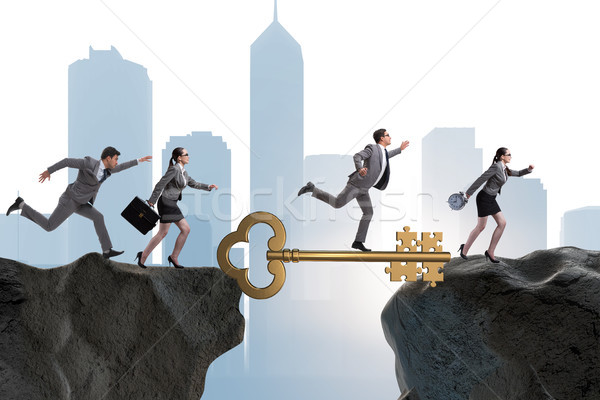Business people chasing each other towards key to success Stock photo © Elnur