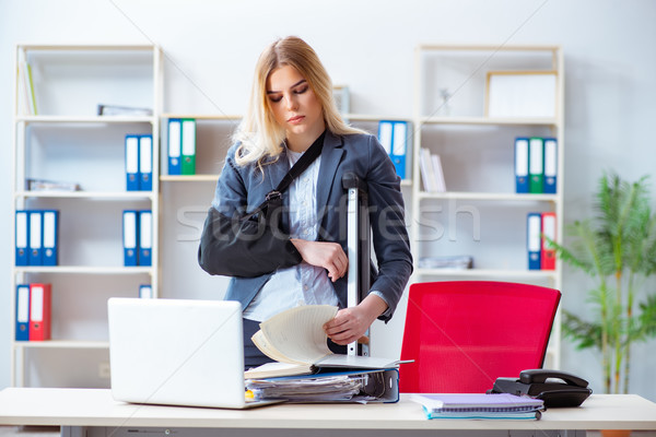 Injured female employee working in the office Stock photo © Elnur