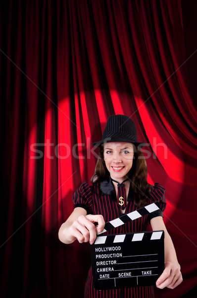 Woman gangster with movie clapper Stock photo © Elnur