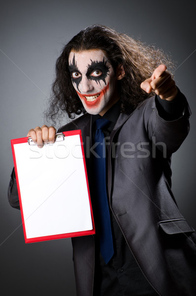 Funny Joker with paper binder Stock photo © Elnur