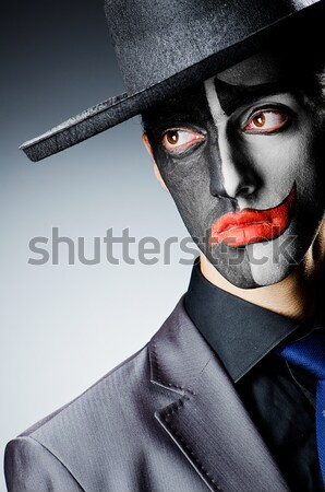 Joker with gun and briefcase Stock photo © Elnur