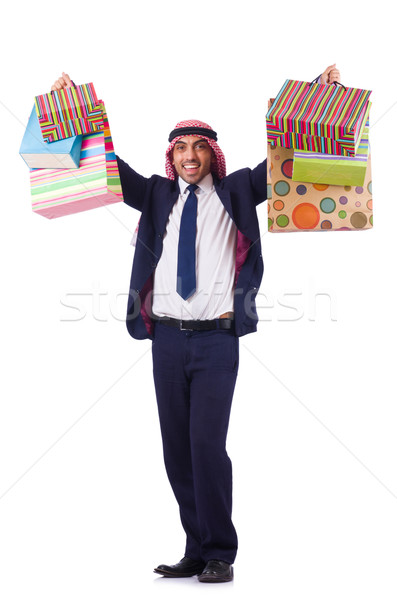 Arab man with shopping gifts on white Stock photo © Elnur