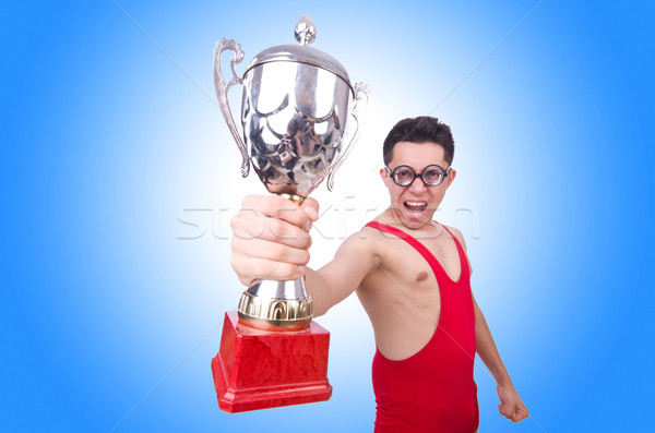 Funny wrestler with winners cup Stock photo © Elnur