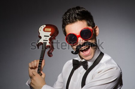 Man wearing sunglasses with gun Stock photo © Elnur