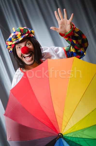 Grappig clown kleurrijk paraplu glimlach man Stockfoto © Elnur