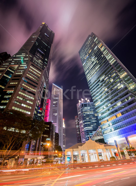 Skysrapers in Singapore during night hours Stock photo © Elnur