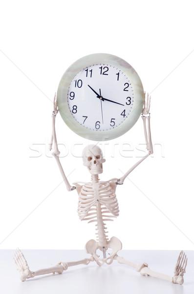 Skeleton with clock isolated on white Stock photo © Elnur