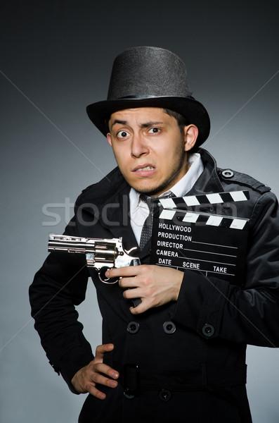 Jonge man wapen grijs achtergrond zakenman film Stockfoto © Elnur