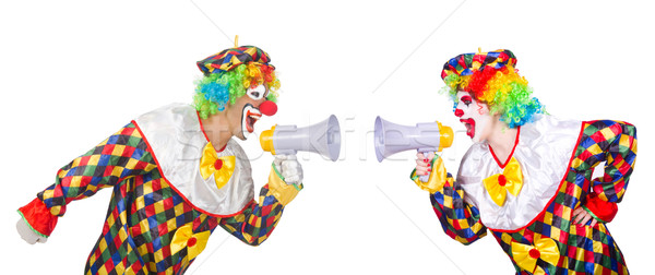 Stock photo: Two clowns with loudspeakers isolated on white
