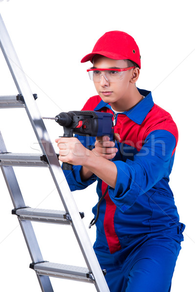 Young repairman with drill perforator isolated on white Stock photo © Elnur