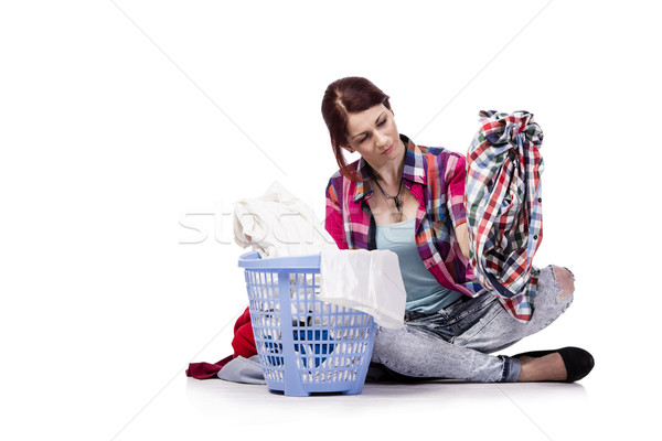 Woman tired after doing laundry isolated on white Stock photo © Elnur