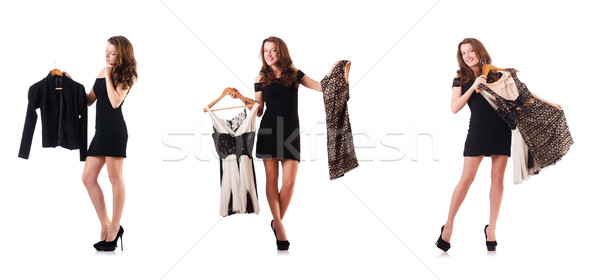 Young woman trying new clothing on white Stock photo © Elnur