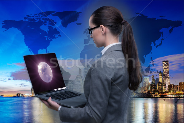Businesswoman with laptop in global business concept Stock photo © Elnur