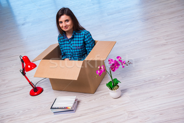Young woman moving personal belongings Stock photo © Elnur